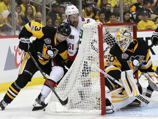 Pittsburgh Penguins defenseman Olli Maatta (3) and Ottawa Senators right wing Mark Stone (61) battle for the puck as the Penguins goalie Matt Murray (30) watches during the third period of Game 7 in the NHL hockey Stanley Cup Eastern Conference finals, Thursday, May 25, 2017, in Pittsburgh. (AP Photo/Keith Srakocic)
