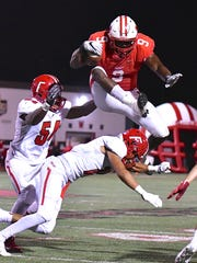 Lakota West's Xavier Peters hurdles the Fairfield defense Friday, September 8th at Lakota West High School