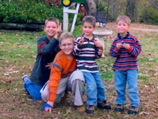 Caleb Wulfert (right) and his three brothers when they were younger in a family photo.