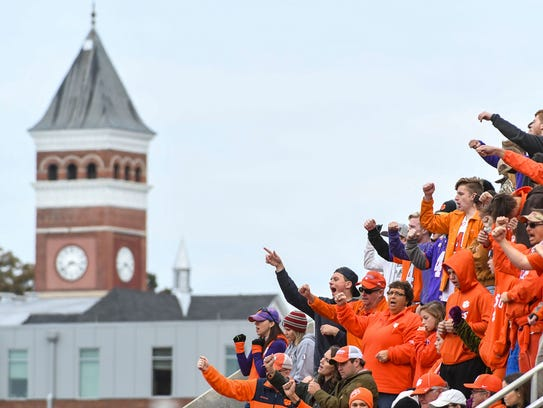 Clemson fans cheer from the upper deck within view