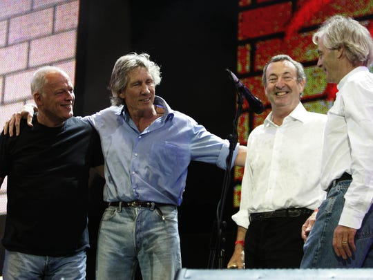 Pink Floyd's David Gilmour, Roger Waters, Nick Mason and Richard Wright acknowledge fans at the end of the band's Live 8 performance in 2005.