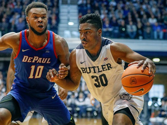 Butler Bulldogs forward Kelan Martin (30) drives around