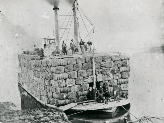 This photo of a steamboat, loaded with cotton in the late 1800s on the Red River in Alexandria before it headed to New Orleans, is part of the Newcomb Photo Collection.