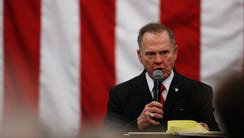 Roy Moore speaks at a campaign rally, Monday, Dec.