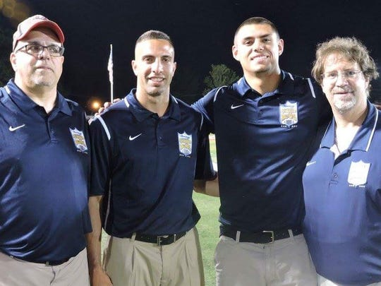 Joe LaSala, second from left, pictured with his father, Ben (left), current Woodbridge assistant Anthony Nyers and former Woodbridge head coach Bill Nyers (right) during the 2016 Snapple Bowl.