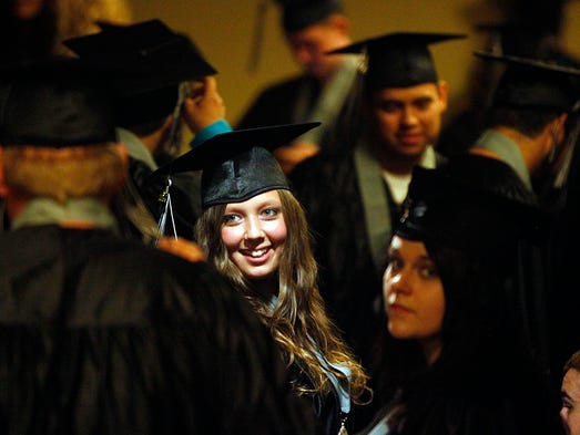 Casey Robinson, center, smiles at fellow graduates prior to the Roberts High School commencement at the Historic Elsinore Theatre Wednesday June 4, 2014.