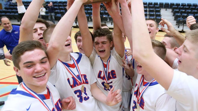 Lake's Joe McBride, center, celebrates the Division I district championship victory over Warren Harding with his teammates on Saturday, March 11, 2017 in Alliance.
