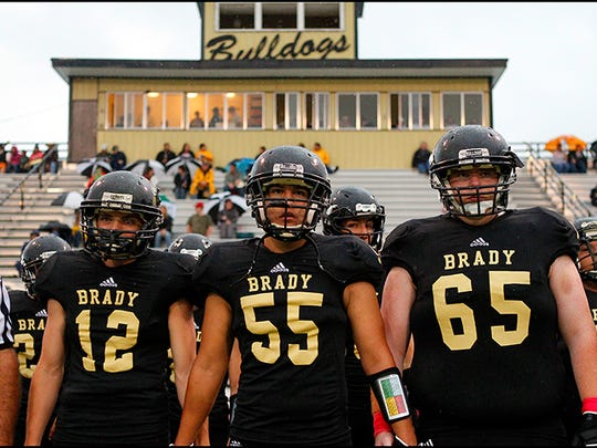 The Brady Bulldogs prepare to take the field before a game in 2013.