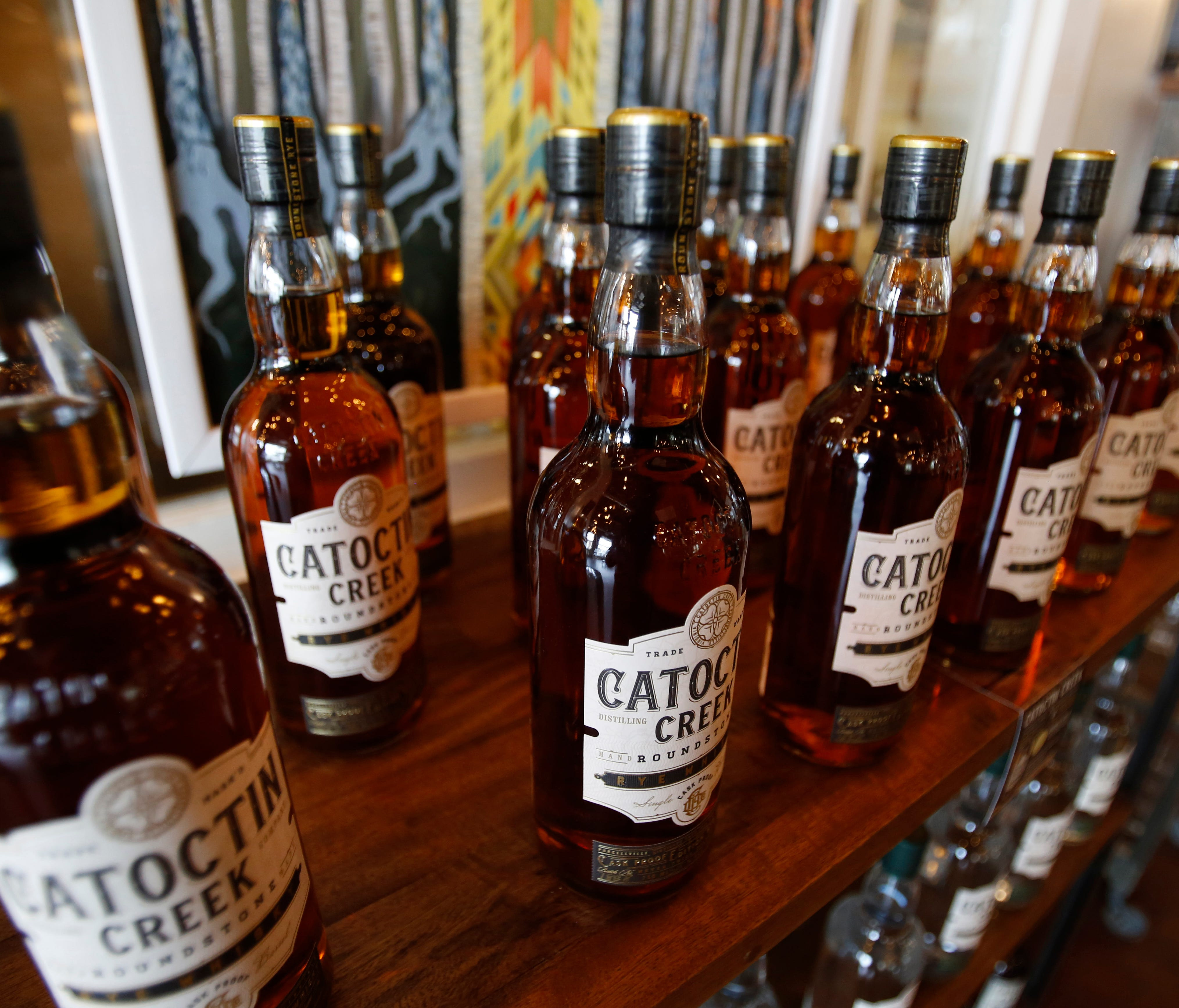 Catoctin Creek Distillery whiskey is on display in the tasting room in Purcellville, Virginia. The European Union on Friday will start taxing a range of U.S. imports, including Harley-Davidson bikes, cranberries, peanut butter, playing cards and whis