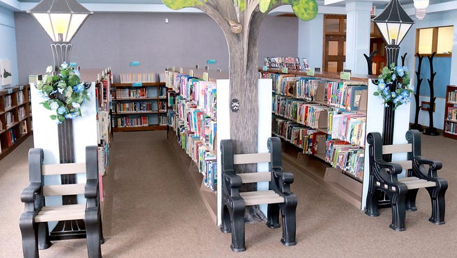 Sturgis District Library has reopened after being shut down for several months due to COVID-19. In the children's part of the facility, reading chairs are spaced apart to maintain social distancing.
