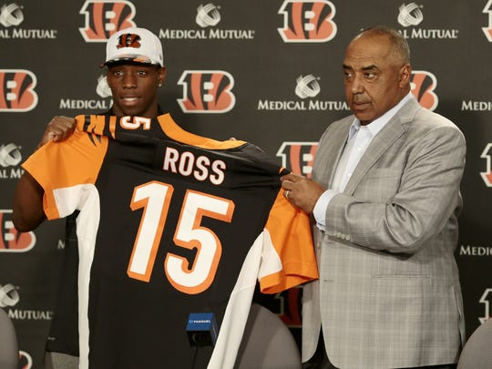 John Ross holds up his No. 15 jersey with head coach Marvin Lewis in a press conference at Paul Brown Stadium in downtown Cincinnati on April 28, 2017.