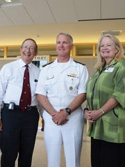 Dr. Lewis First, left, chief of Pediatrics at the UVM Children's Hospital, and Eileen Whalen, president and chief operating officer of the University of Vermont Medical Center, welcome Navy Vice Adm. Tom Rowden to the hospital during his visit Tuesday