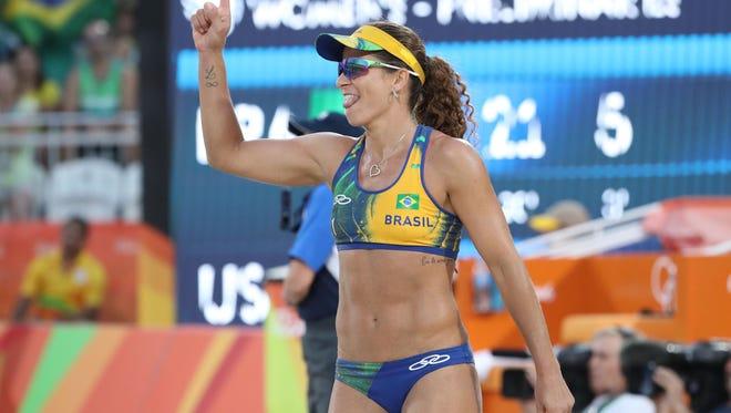 Larissa Franca Maestrini celebrates against the United States.