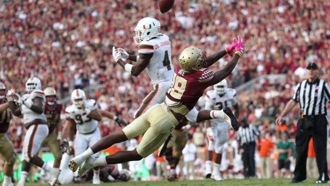 Miami's Jaquan Johnson deflects a ball away from FSU's Auden Tate during their game at Doak Campbell Stadium on Saturday, Oct. 7, 2017.