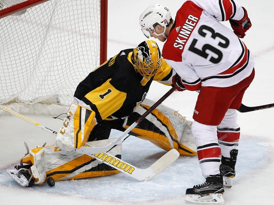 Pittsburgh Penguins' Casey DeSmith (1) blocks a shot by Carolina Hurricanes' Jeff Skinner (53) in the first period of an NHL hockey game in Pittsburgh, Tuesday, Jan. 23, 2018. (AP Photo/Gene J. Puskar)