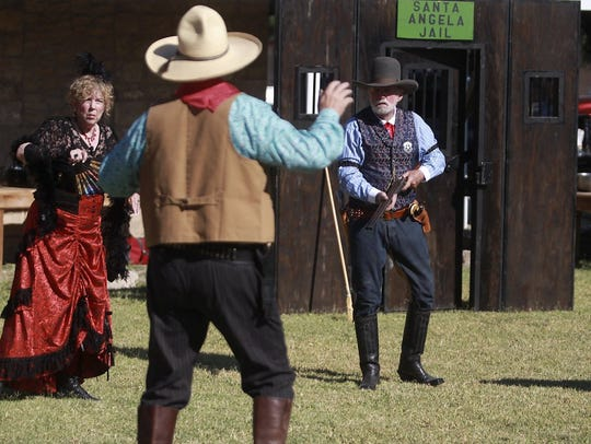 Old West actors from the Concho Cowboy Company perform