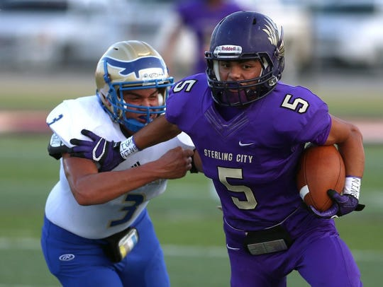 Sterling City's Josue Rodriguez tries to fight off
