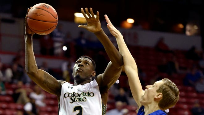 CSU forward Emmanuel Omogbo (2) shoots against San Jose State's Ryan Welage during the first half of Wednesday's Mountain West tournament game in Las Vegas.
