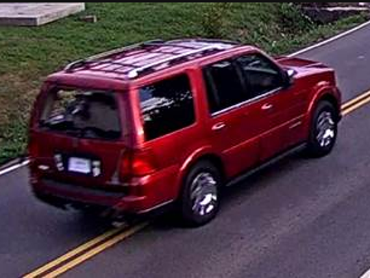 Metro police are searching for this red Lincoln Navigator