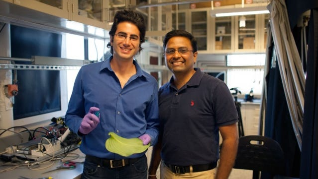 A team of researchers, including graduate student Maher Damak (left) and associate professor of mechanical engineering Kripa K. Varanasi, have found a way to drastically cut down on the amount of pesticide liquid that bounces off plants.