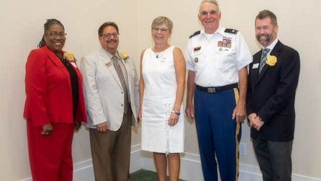 Impact 100 grant recipients (from left): Nancy McCurry (Economic Opportunities Council of IRC), Felix Cruz (Youth Guidance Mentoring and Activities Program), Suzanne Carter (Impact 100 president), Sam Kouns (Veterans Council of Indian River County) and Jeffrey Shearer (Tykes & Teens Inc.)