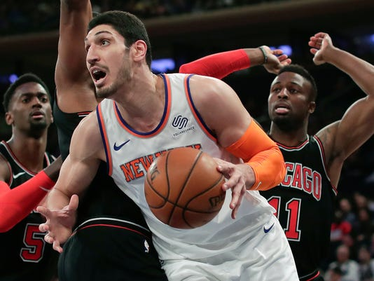 New York Knicks center Enes Kanter (00) drives to the basket against the Chicago Bulls during the first quarter of an NBA basketball game, Monday, March 19, 2018, in New York. (AP Photo/Julie Jacobson)