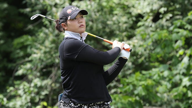 Aryia Jutanugarn watches her tee shot on the sixth hole Sunday.