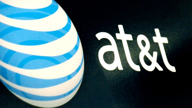 AT&T logo is on display at a RadioShack store in Gloucester, Mass.