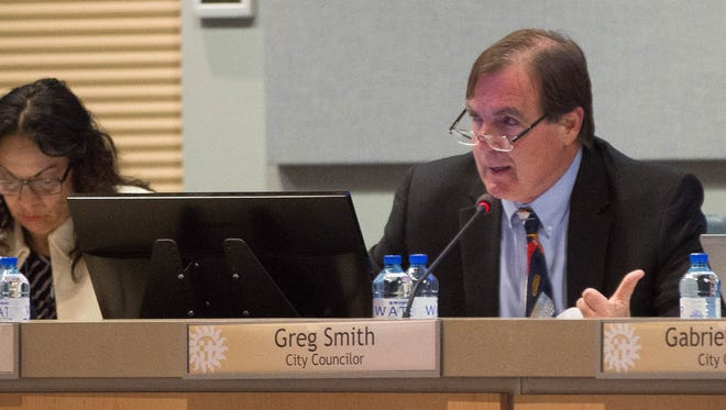 Greg Smith, city councilor for district 2, introduces a proposal to ask tate lawmakers to implement restrictions on sale and possessions of semi- automatic guns, Monday March 19, 2018.