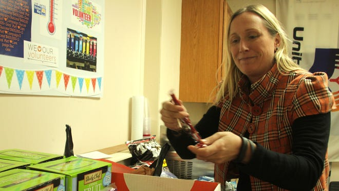 United Way of Otero County Director of Marketing and Public Relations Michelle Brideaux sorts donated Halloween candy to be sent in care packages to deployed troops at the United Way offices at 1601 Tenth Street. The organization is accepting donations through Nov. 9.