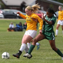 One of Schoolcraft's stellar performers Saturday, sophomore Jessica Parry (No. 25) battles for the ball against Cincinnati State's Deandre Criddell (No. 12). Parry scored a goal in the Lady Ocelots' 2-0 victory.
