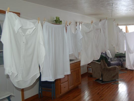 Clothing hangs inside the Amish home after freezing