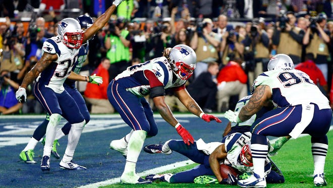 Patriots strong safety Malcolm Butler (21) celebrates with teammates after intercepting a pass late in Super Bowl XLIX.