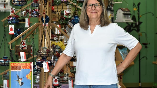 Laura Hopkins shows off birding accessories in her Lakeway Town Center shop on Friday. Hopkins, who co-owns the Wild Bird Center of Lakeway with husband Gary Cobb, said she's noticed an increase of customers in their store since the pandemic began this spring.
