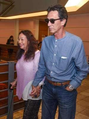 Singer Yvonne Elliman-Alexander, left, and Allen Alexander, walk away from the courtroom after an ex parte hearing at the Superior Court of Guam on Wednesday, Aug. 30, 2017. The singer and her husband appeared before Judge Vernon Perez to request permission, through their attorney Mike Phillips, to return to their home in Hawaii until future proceedings regarding their drug case pending in the local court.