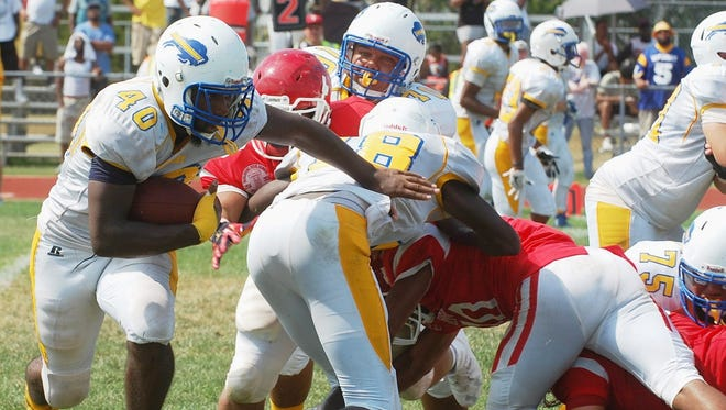 Woodbury senior Jaquan Solomon rushed for 150 yards and a touchdown in Saturday's victory over rival Paulsboro.