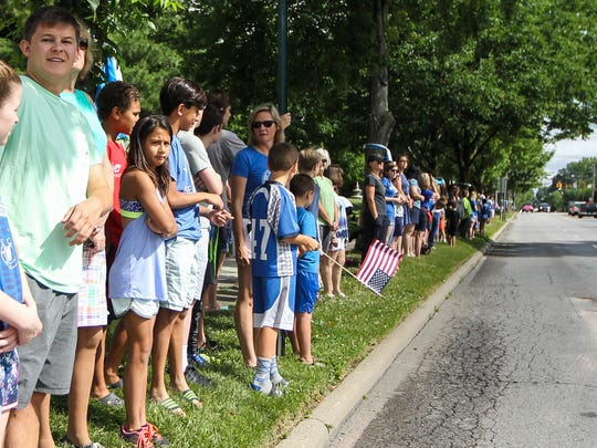 Wyoming residents line Springfield Pike in support of Otto Warmbier and his family Thursday, June 14, 2017.