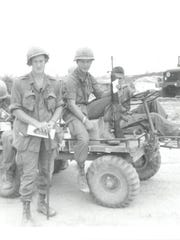Douglas MacArthur McCrary, standing, in Vietnam.