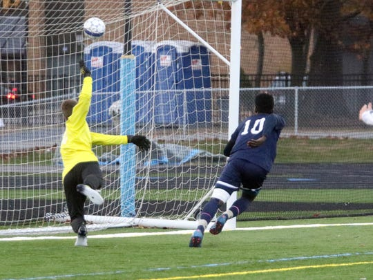 Burlington's Bienfait Badibanga heads in a crossing pass to tie the game at 1-1 with 38:00 left to play. South Burlington went on to win 2-1.