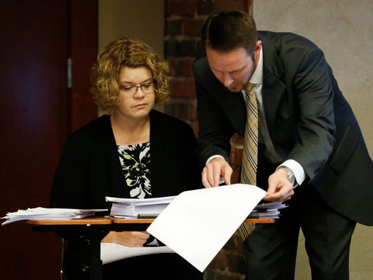 WellCare attorney Andre Hendrick (right) pulls up a document for former Republican state legislator Renee Schulte to read Thursday, Oct. 29, 2015, as she testifies about her role with WellCare and its bid to manage Iowa's Medicaid program.