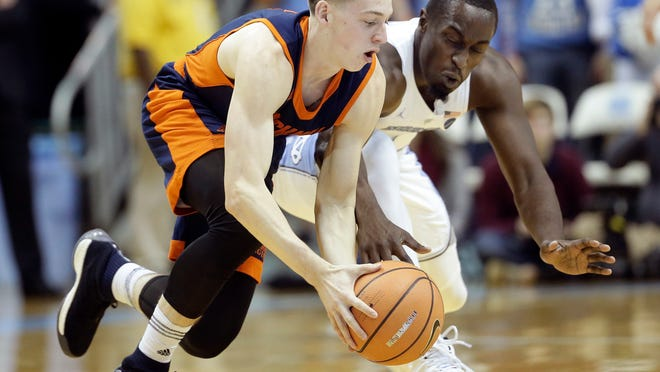 North Carolina's Theo Pinson, right, and Bucknell's Jimmy Sotos chase the ball during the first half of an NCAA college basketball game in Chapel Hill, N.C., Wednesday, Nov. 15, 2017. (AP Photo/Gerry Broome)