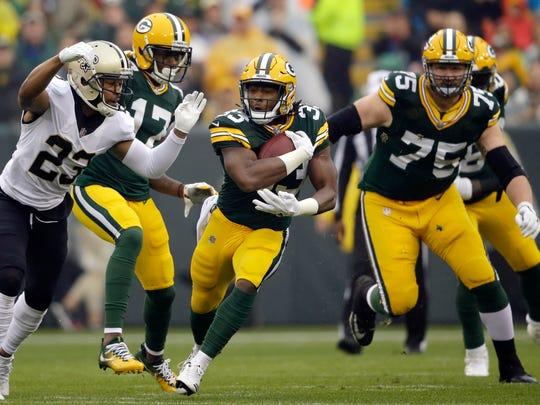 Saints cornerback Marshon Lattimore tackles Packers running back Aaron Jones in the first half Oct. 22.