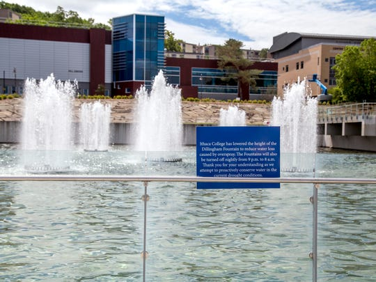 The height of the Dillingham Fountain has been reduced to conserve water at Ithaca College. A sign in front of the fountain tells students that, to reduce waste from overspray, the fountain will be turned off at night.