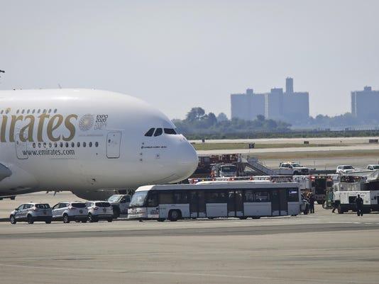 APTOPIX Plane Sick Passengers