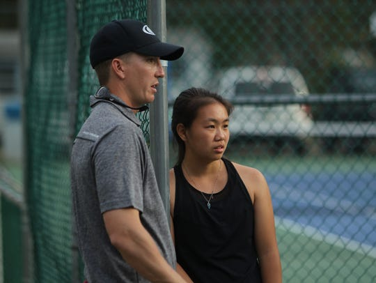 Chiles tennis coach Owen Long talks to junior Ashley