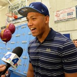 Mique Juarez is interviewed by the media after he selected UCLA as his choice for college football today at North High School in Torrance, California.