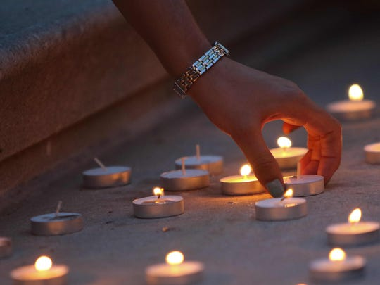 Candles are lit for victims of the Nepal earthquake.