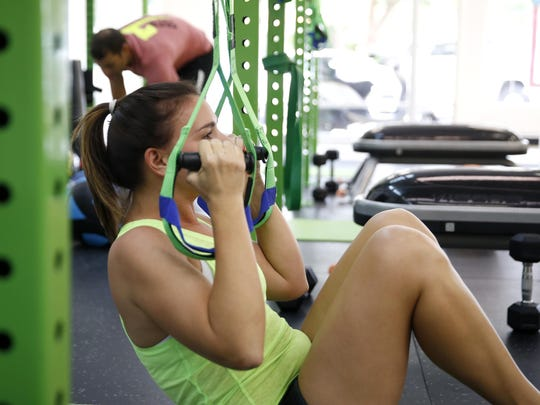 Erin Wilder, a 'foundation' level trainee at Fit & Functional gym, works out at the facility on Thursday, Aug. 6, 2015. The Core 7 philosophy holds seven progressive levels of training, each with its own label, from 'foundation' to 'performance.'