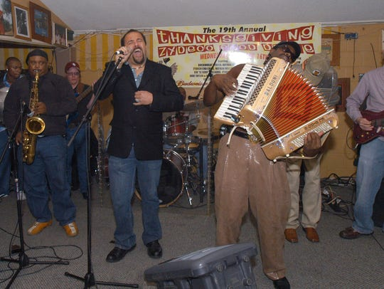 Terrance Simien and C. J. Chenier, center, perform