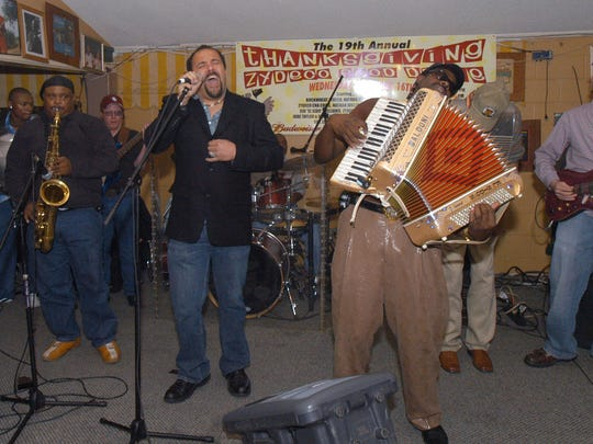 Terrance Simien and C. J. Chenier, center, perform at the 19th Annual Thanksgiving Zydeco Food Drive.